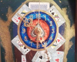 I made this clock about 5 years ago. Acrylics, playing cards, and clock kit